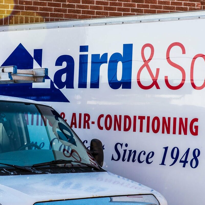laird and son heating and air conditioning trucks - main slider